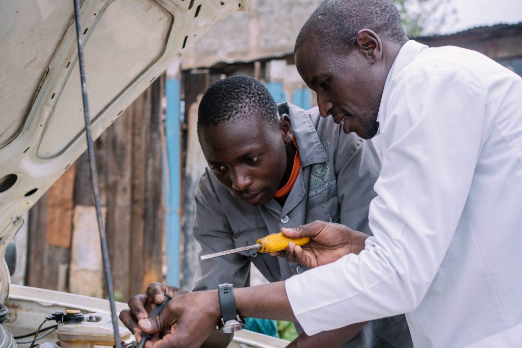 Mechanics teacher showing student